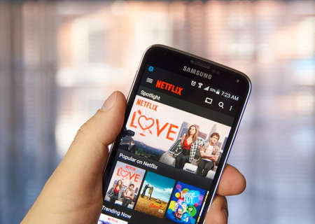 MONTREAL, CANADA - MARCH 4, 2016 - Netflix application running on android Samsung S5. Netflix is one of the most popular global provider of streaming movies. Editorial