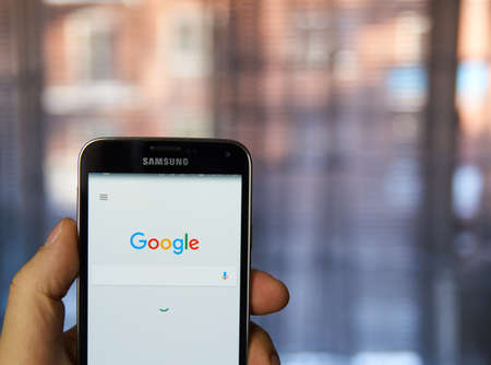 google: MONTREAL, CANADA - MARCH 4, 2016 - Google mobile application on Samsung devices screen in a hand. Google is well known for its web search engine.