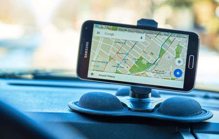 MONTREAL, CANADA - FEBRUARY, 2016 - GPS application Google Maps, running on Samsung S5 in a car. Google Maps is one of the most popular GPS applications.