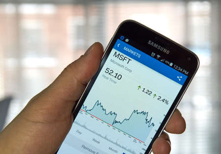 microsoft: MONTREAL, CANADA - MARCH, 2016 -  MSFT - Microsoft stock ticker with chart on screen of mibile Samsung S5 in a hand. Microsoft Corporation is an American multinational technology company.