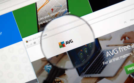antivirus software: MONTREAL, CANADA - MARCH, 2016 - AVG antivirus web page under magnifying glass. AVG is one of the popular antivirus software.