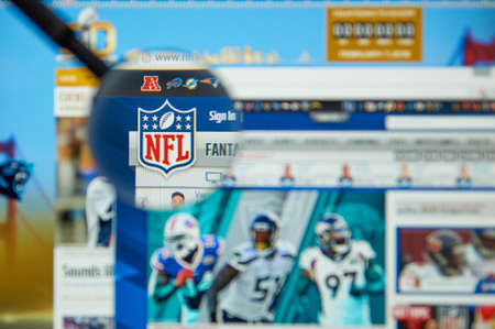 nfl: MONTREAL, CANADA - MARCH 8, 2016 - NFL official site and logo under magnifying glass. The National Football League is a professional American football league that constitutes one of the four major professional sports leagues in the USA.