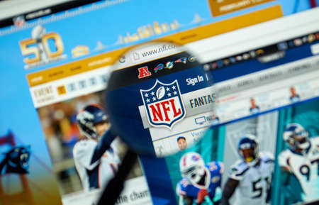 constitutes: MONTREAL, CANADA - MARCH 8, 2016 - NFL official site and logo under magnifying glass. The National Football League is a professional American football league that constitutes one of the four major professional sports leagues in the USA.