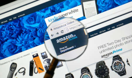 amazon com: MONTREAL, CANADA - MARCH 9, 2016 - Amazon on the web under magnifying glass. Amazon, is an American electronic commerce and cloud computing company.