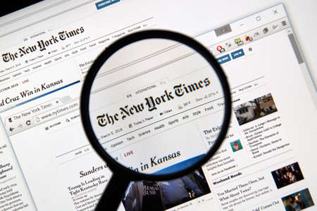 MONTREAL, CANADA - MARCH 5, 2016 - The New York Times web page under magnifying glass. Editorial