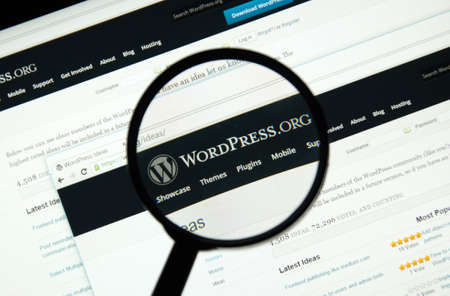 MONTREAL, CANADA - MARCH 5, 2016 - Wordpress web page under magnifying glass. Editorial
