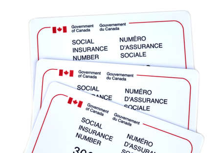 requires: MONTREAL, CANADA - MARCH 4, 2016 - Canadian social Insurance number card over white.  The Social Insurance Number is a number that requires to work in Canada or to receive government benefits.