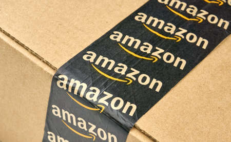 amazon com: MONTREAL, CANADA - MARCH 10, 2016 - Amazon shipping box with branded tape on it. Amazon is one of the most popular and biggest online store. Editorial