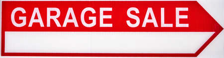 Garage sales red arrow sign on white plastic.