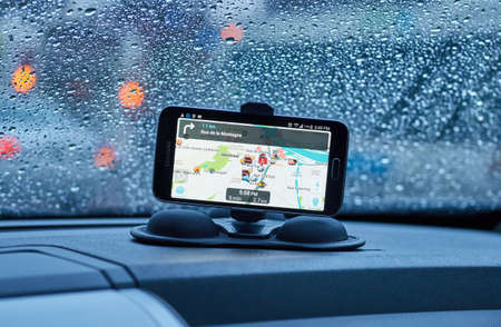 MONTREAL, CANADA - MARCH 15, 2016 - GPS application Waze running on Samsung S5 in a car. Waze is one of the most popular GPS applications.
