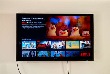 american media: MONTREAL, CANADA - MARCH 20, 2016 - Netflix application running on LG TV. Netflix is a well known global provider of streaming movies and TV series. Editorial