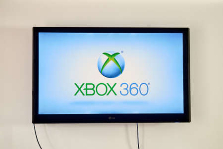 xbox: MONTREAL, CANADA - MARCH 20, 2016 - Xbox  on LG TV screen. Xbox is a video gaming brand created and owned by Microsoft.
