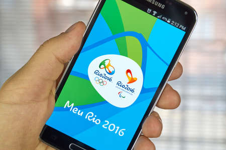 olympiad: MONTREAL, CANADA - MARCH 20, 2016 - Rio 2016 mobile application on Samsung S5s screen. The city of Rio de Janeiro has been elected host city of the Games of the XXXI Olympiad in 2016.