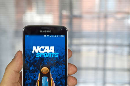 samsung: MONTREAL, CANADA - MARCH 20, 2016 - NCAA mobile application on Samsung S5s screen. NCAA is National Collegiate Athletic Association.