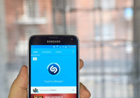 samsung: MONTREAL, CANADA - MARCH 20, 2016 - Shazam mobile application on Samsung S5s screen. Shazam is a free application that helps users figure out the name of a catchy song.