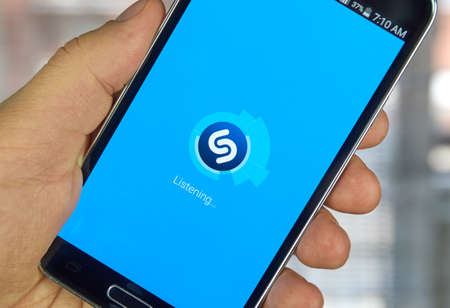 MONTREAL, CANADA - MARCH 20, 2016 - Shazam mobile application on Samsung S5s screen. Shazam is a free application that helps users figure out the name of a catchy song.