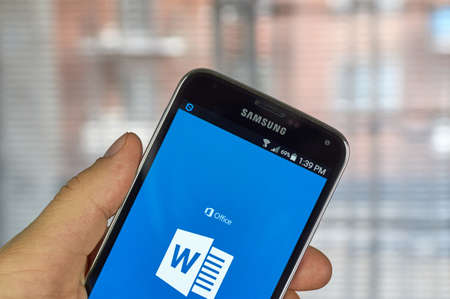 microsoft: MONTREAL, CANADA - MARCH 20, 2016 - Microsoft Office Word mobile application on Samsung S5s screen. Microsoft Office is one of the most popular office suite software.
