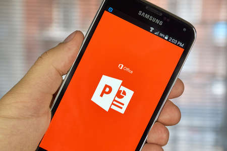 samsung: MONTREAL, CANADA - MARCH 20, 2016 - Microsoft Office Power Point mobile application on Samsung S5s screen. Microsoft Office is one of the most popular office suite software.