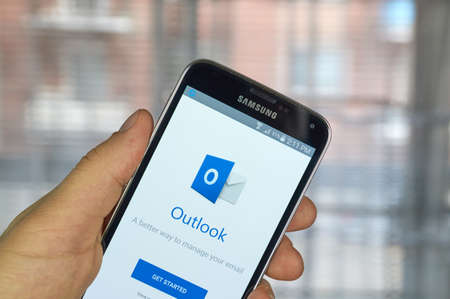 samsung: MONTREAL, CANADA - MARCH 20, 2016 - Microsoft Office Outlook mobile application on Samsung S5s screen. Microsoft Office is one of the most popular office suite software.