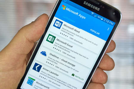samsung: MONTREAL, CANADA - MARCH 20, 2016 - Microsoft Office mobile applications on Samsung S5s screen. Microsoft Office is one of the most popular office suite software. Editorial