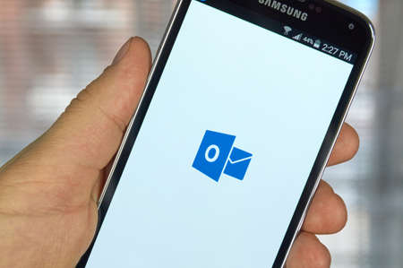 microsoft: MONTREAL, CANADA - MARCH 20, 2016 - Microsoft Office Outlook mobile application on Samsung S5s screen. Microsoft Office is one of the most popular office suite software.