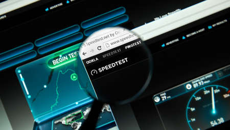 MONTREAL, CANADA - MARCH 25, 2016 - Speedtest internet service under magnifying glass.