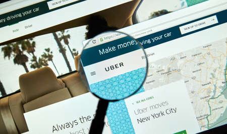 MONTREAL, CANADA - MARCH 25, 2016 - Uber online service under magnifying glass. Uber Technologies Inc. is an American multinational online transportation network. Editorial