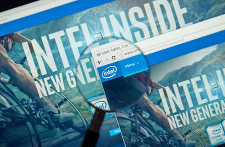 intel: MONTREAL, CANADA - MARCH 25, 2016 - Intel internet page under magnifying glass. Intel Corporation is an American multinational technology company.