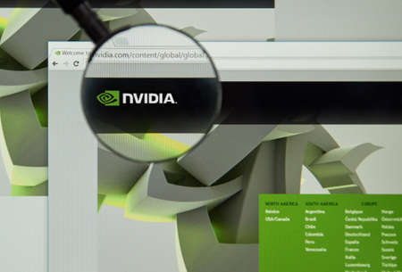 dvi: MONTREAL, CANADA - MARCH 25, 2016 - Nvidia internet page under magnifying glass. NVIDIA Corporation is an American technology company.