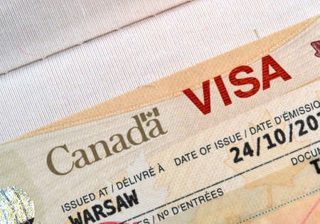 Canadian immigration Visa in passport Foto de archivo