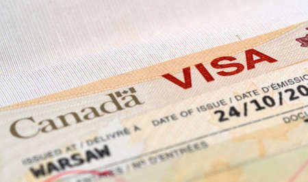 canada stamp: Canadian immigration Visa in passport Stock Photo