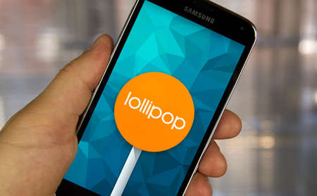 operating system: MONTREAL, CANADA - MARCH 20, 2016 - Android lollipop OS logo on smartphone.  Android Lollipop is a version of the Android mobile operating system developed by Google