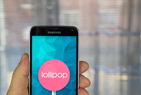 os: MONTREAL, CANADA - MARCH 20, 2016 - Android lollipop OS logo on smartphone.  Android Lollipop is a version of the Android mobile operating system developed by Google