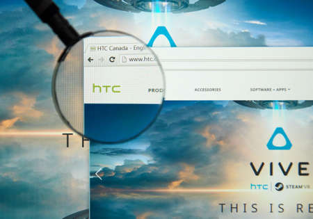 MONTREAL, CANADA - MARCH 25, 2016 - HTC internet page under magnifying glass. HTC Corporation is a Taiwanese multinational manufacturer of smartphones and tablets.