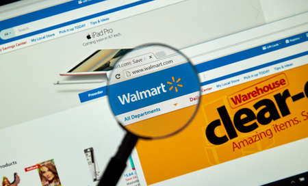 MONTREAL, CANADA - MARCH 25, 2016 - Walmart internet page under magnifying glass. Walmart is an American multinational retail corporation that operates a chain of hypermarkets