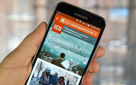 MONTREAL, CANADA - APRIL 5, 2016 : ICIJ web page on mobile phone. ICIJ is International Consortium of Investigative Journalists and well known for The Panama Papers.