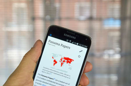 wikipedia: MONTREAL, CANADA - APRIL 5, 2016 : The Panama Papers  page on Wikipedia on Samsung S5 phone. The Panama Papers is the biggest leak in history.