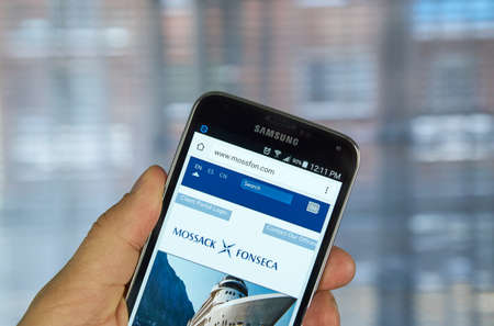 law of panama: MONTREAL, CANADA - APRIL 5, 2016 : Mossack Fonseca page on mobile phone. Mossack Fonseca is a Panamanian law firm well known for the biggest leak in the history called The Panama Papers. Editorial