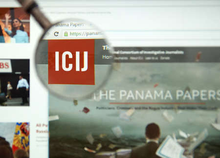 paper money: MONTREAL, CANADA - APRIL 5, 2016 : The Panama Papers web page under magnifying glass. Its a leaked set of 11.5 million confidential documents.