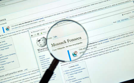 investigative: MONTREAL, CANADA - APRIL 5, 2016 : Mossack Fonseca page on Wikipedia. Mossack Fonseca is a Panamanian law firm well known for the biggest leak in the history called The Panama Papers. Editorial