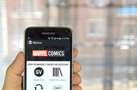 marvel: MONTREAL, CANADA - APRIL 5, 2016 : Marvel Comics app on a cell phone. Marvel Comics is a comic book publishing house famous for creating notable characters such as Spider-Man, Captain America etc. Editorial