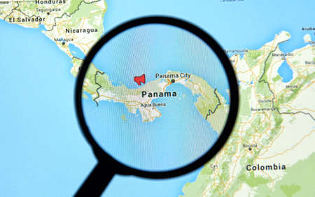 investigative: MONTREAL, CANADA - APRIL 7, 2016 : Panama on a map with  mouthpiece icon under magnifying glass. Panama is a well known country for its recent  documents leak called The Panama Papers.