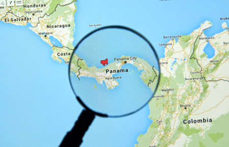 MONTREAL, CANADA - APRIL 7, 2016 : Panama on a map with  mouthpiece icon under magnifying glass. Panama is a well known country for its recent  documents leak called The Panama Papers.