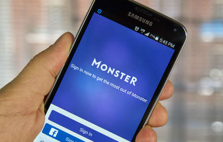 seeking solution: MONTREAL, CANADA - APRIL 7, 2016 : Monster job search application on a cell phone. Monster is a global online employment solution for people seeking jobs.