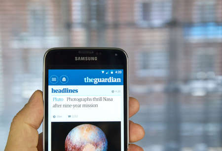 daily newspaper: MONTREAL, CANADA - MARCH 20, 2016 - The Guardian newspaper mobile application on Samsung S5s screen. The Guardian is a British national daily newspaper.