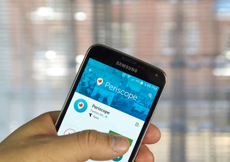 MONTREAL, CANADA - APRIL 7, 2016 : Periscope application on a cell phone. Periscope is a live video streaming app for iOS and Android developed by Kayvon Beykpour and Joe Bernstein.