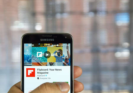 aggregation: MONTREAL, CANADA - APRIL 7, 2016 : Flipboard application on a cell phone. Flipboard is a social-network aggregation, magazine-format mobile app. Editorial