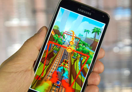 surfers: MONTREAL, CANADA - APRIL 5, 2016 :  Subway Surfers game on android device. Subway Surfers is a Temple Run-style game where you have to escape from a railway inspector. Editorial