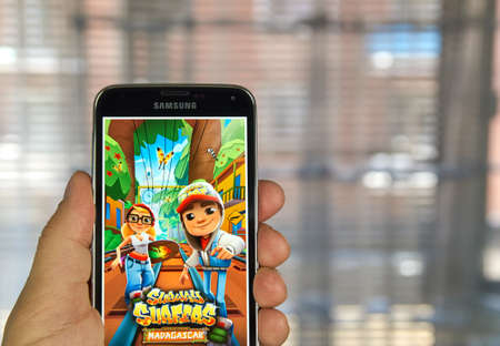google play: MONTREAL, CANADA - APRIL 5, 2016 :  Subway Surfers game on android device. Subway Surfers is a Temple Run-style game where you have to escape from a railway inspector. Editorial