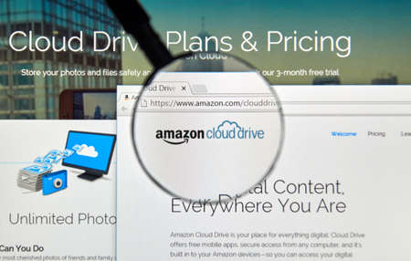 electronic commerce: MONTREAL, CANADA - MAY 8, 2016 : Amazon Cloud Drive web page under magnifying glass. Amazon Cloud Drive is a web storage application from Amazon.